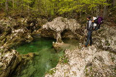 Mother and a bay watching scenic Mostnice glacier gorge near Bohinj in Slovenia Stock Image