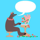 Mother bear by laptop and many flowers stock photography