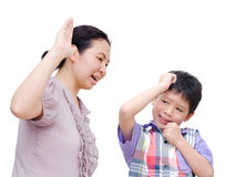Mother Being Physically Abusive Towards Son. Asian mother Being Physically Abusive Towards Son Over White Background Stock Photo