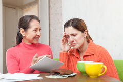 Mother berates adult daughter for bills Royalty Free Stock Image