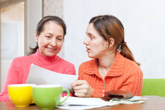 Mother berates adult daughter for  bills Stock Photography