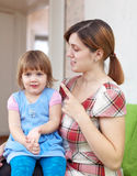 Mother berates her baby Stock Photography