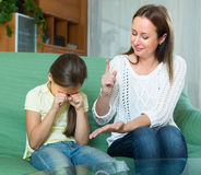 Mother berating  crying daughter Royalty Free Stock Photo