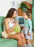 Mother berating little child Royalty Free Stock Photo