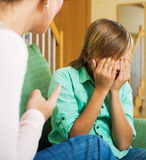Mother berating teenager son Royalty Free Stock Image