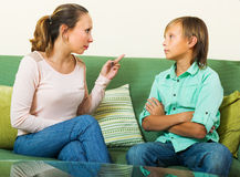 Mother berating teenager son Royalty Free Stock Photography