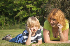 Mother and blond boy calling. Stock Photo