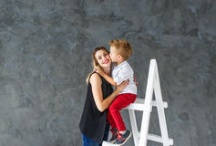 Mother and blond son on a step-ladder Royalty Free Stock Images