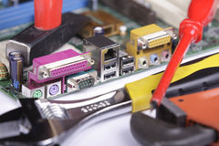Mother Board. Repairing of the circuit board Royalty Free Stock Image
