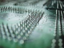 Mother board. Close up of circuit board out of depth of field royalty free stock image