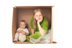 Mother in box with baby eating cookie Stock Photography