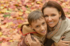 Mother with boy in autumn park Royalty Free Stock Photo