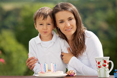 Mother and boy, celebrating his birthday outdoor. In the garden Stock Images
