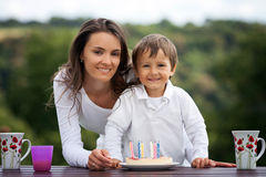 Mother and boy, celebrating his birthday outdoor Stock Photos