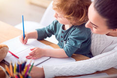 Mother and a boy drawing Stock Photo