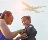 Mother and boy dreaming to be a plane pilot. Mother and   boy dreaming to be a plane pilot Royalty Free Stock Photo