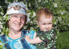 Mother and boy beside flowering aple tree Stock Image