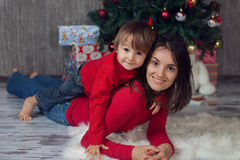 Mother with boy in front of a christmas tree Stock Photo