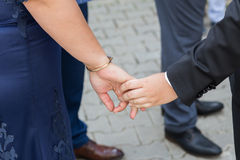 Mother and boy holding hands Stock Images