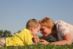 Mother with boy lies Royalty Free Stock Image