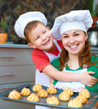Mother with boy making bread Royalty Free Stock Image