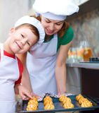 Mother with boy making bread Royalty Free Stock Images