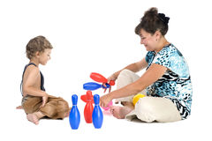 Mother with boy play skittles. People on white - mother with boy play skittles Stock Photo