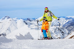 Mother with boy skiers in mountains Stock Image