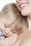 Mother With Boy Sleeping On Her Chest Royalty Free Stock Photo