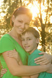 Mother with boy in summer park Royalty Free Stock Photo