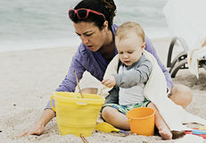 Mother & Boy Toddler Play on a Beach in Mexico Stock Photo