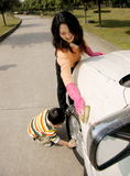 Mother and boy washing car. A picture of a little chinese boy and his mother washing car hard and happily Stock Photos