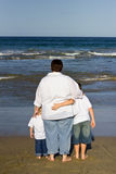 Mother with boys on beach Royalty Free Stock Photography
