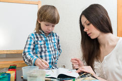 Mother with boys son paint colors at home Stock Image