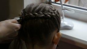 Mother braiding daughter beautiful braid. stock video