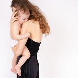 Mother breast feeding a cute baby. Newborn girl. Royalty Free Stock Images