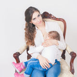 Mother breast feeding a cute baby. Newborn girl. Stock Images