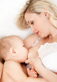 Mother breast feeding her baby Stock Photo