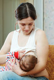 Mother breast feeding her baby Stock Photos