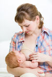 Mother breast feeding her infant baby Royalty Free Stock Photos