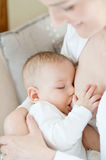 Mother breast feeding her infant - breastfeeding Royalty Free Stock Photo