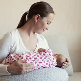 Mother breast feeding her infant Stock Image