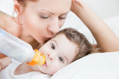 Mother breast feeding her infant Stock Images
