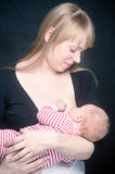Mother breast feeding her little son Stock Image