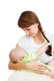 Mother breast feeding and hugging her baby Royalty Free Stock Images