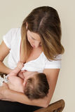 Mother Breastfeeding Baby Stock Images