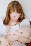 Mother breastfeeding her baby Royalty Free Stock Photos