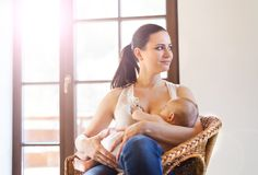 Mother breastfeeding her baby Stock Photo