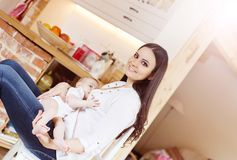 Mother breastfeeding her baby. Mother breastfeeding her little baby girl in her arms stock image