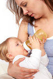 Mother breastfeeding her child. Young Mother and pretty child Stock Photography